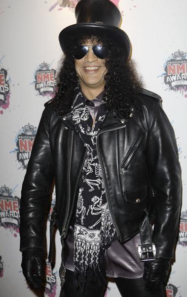 U.S guitarist Slash arrives for the NME 2010 awards in south London, Wednesday, Feb. 24, 2010. (AP Photo/Joel Ryan)