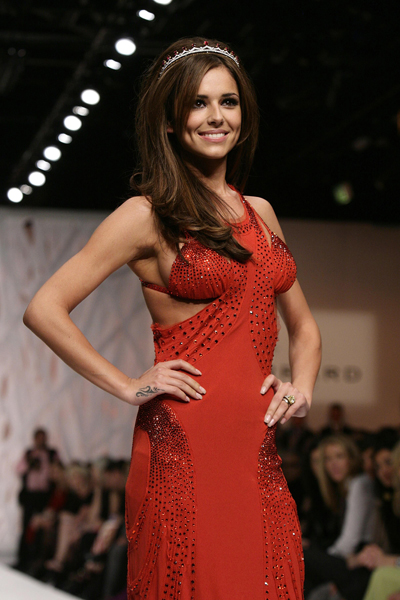 File photo dated 17/09/08 of Cheryl Cole during the Fashion for Relief show during London Fashion Week at the BFC Tent, Natural History Museum, London.