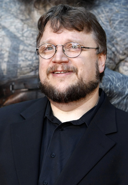 """** FILE ** In this June 28, 2008 file photo, director Guillermo del Toro pose on the press line at the premiere of the feature film """"Hellboy II: The Golden Army"""" in Los Angeles. (AP Photo/Dan Steinberg, file)"""