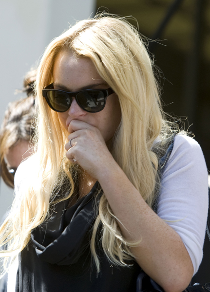 Actress Lindsay Lohan leaves the Beverly Hills Municipal Courthouse in Beverly Hills, California, USA.