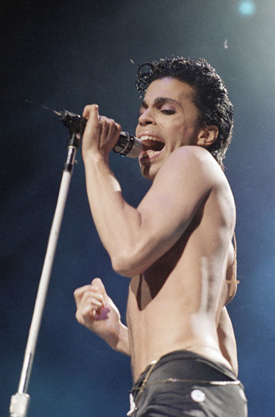 Prince performs at Madison Square Garden in New York CIty, August 2, 1986, with his band, The Revolution. (AP Photo/Mario Suriani)