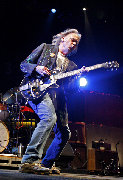 Neil Young performs at Madison Square Garden Monday, Dec. 15, 2008 in New York. (AP Photo/Jason DeCrow)