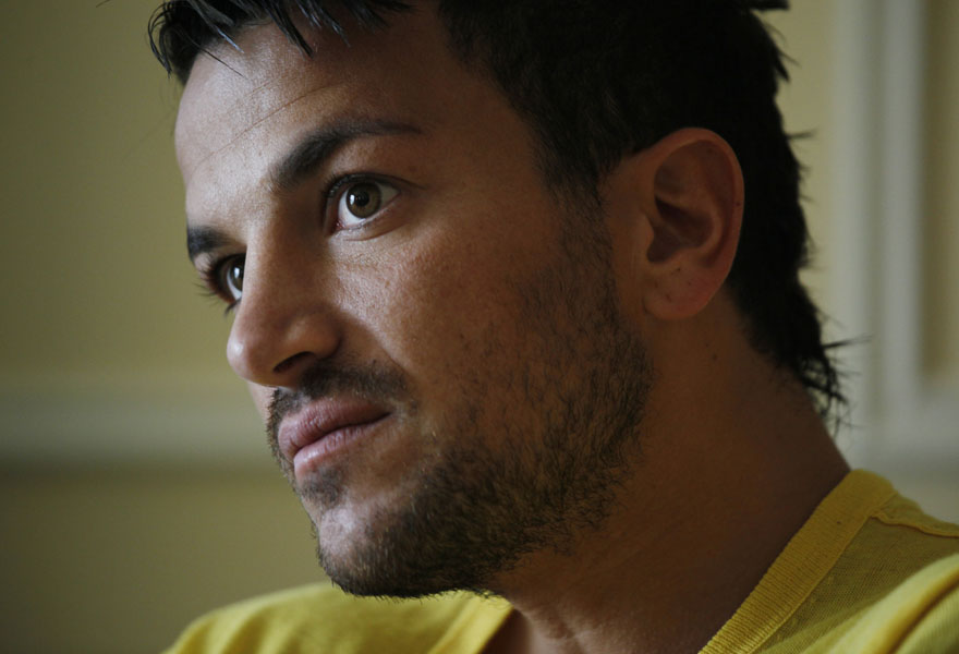 Singer Peter Andre reacts during an interview at the 10th International Indian Film Awards presentation at a casino-hotel complex in Macau, Saturday, June 13, 2009. (AP Photo/Vincent Yu)