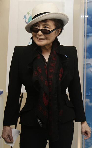 Artist and musician Yoko Ono pictured with a piece of her original mural titled PROMISE at the United Nations in New York, USA. The mural will be broken up into 62 pieces and auctioned off in support of Autism Speaks as part of the 2nd Annual World Autism Awareness Day.