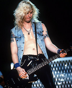 Duff McKagen, bass player for the Guns and Roses, performing live in concert.