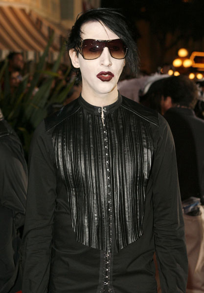 "Musician Marilyn Manson poses for photographers at the film premiere of ""Pirates of the Caribbean: Dead Man's Chest,"" at the Disneyland theme park in Anaheim, Calif., on Saturday, June 24, 2006. (AP Photo/Matt Sayles)"