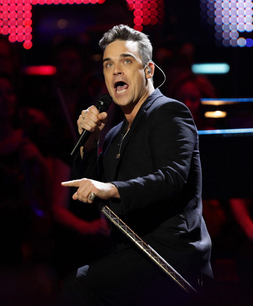 EXCLUSIVE TO PRESS ASSOCIATION IMAGES. EDITORIAL USE ONLY Robbie Williams joins his ex-band mates - Take That on stage for a special performance at the BBC Children in Need Rocks Rocks The Royal Albert Hall 2009 concert, at the Royal Albert Hall in west London.