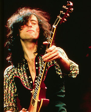Jimmy Page of Led Zepplin.live, performing.