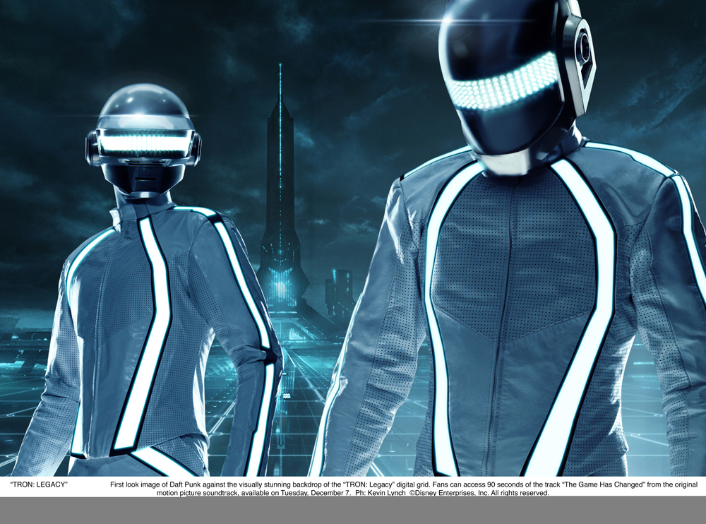 """TRON: LEGACY""    First look image of Daft Punk against the visually stunning backdrop of the ""TRON: Legacy"" digital grid. Fans can access 90 seconds of the track ""The Game Has Changed"" from the original motion picture soundtrack, available on Tuesday, December 7.  Ph: Kevin Lynch  ©Disney Enterprises, Inc. All rights reserved."