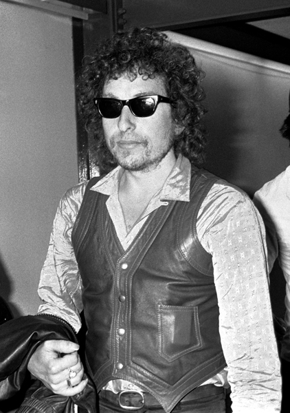 Folk singer Bob Dylan arrives at Heathrow airport, for a concert at London's Earls Court.