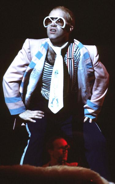 Elton John live in concert in London, circa 1976.