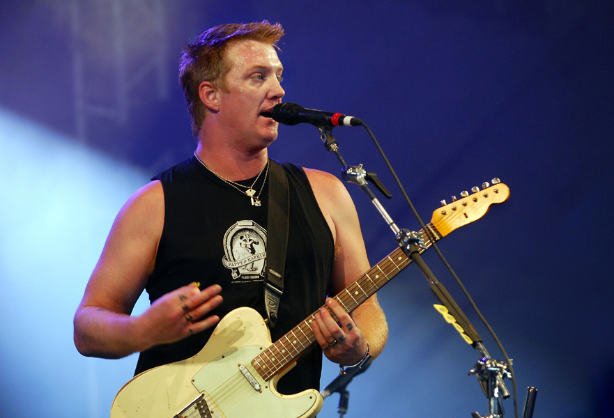 Josh Homme of Them Crooked Vultures performs live on stage on Day 2 of Reading Festival 2009.