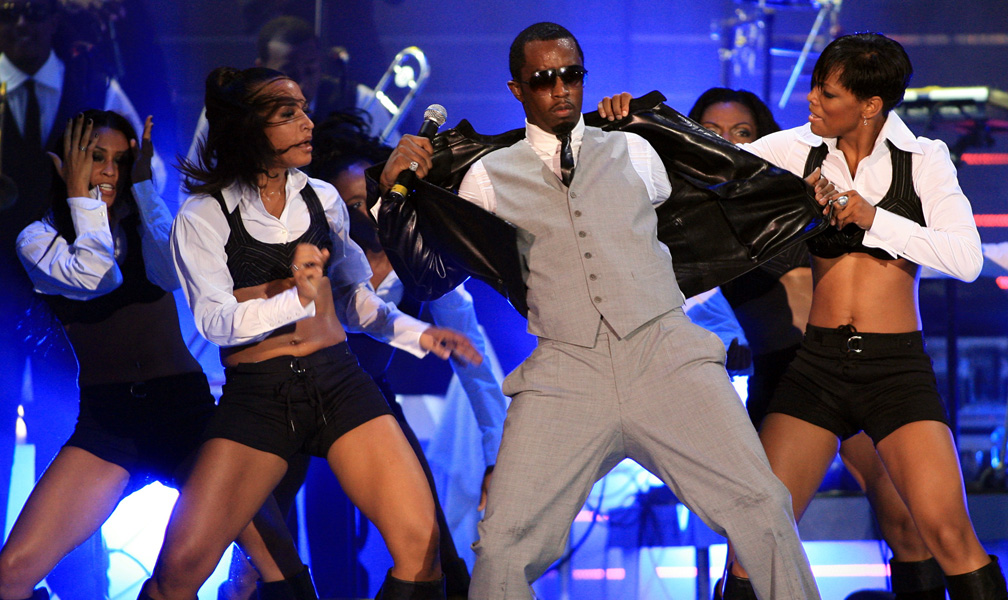 Grammy award winner Diddy performs at the 2006 NFL Opening Kickoff concert Thursday, Sept. 7, 2006 in Miami Beach, Fla. (AP Photo/Luis M. Alvarez)