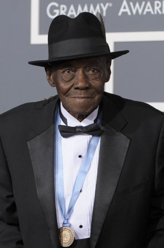In this Feb. 13, 2011 photo, blues pianist Pinetop Perkins arrives at the 53rd annual Grammy Awards in Los Angeles. Perkins, one of the last old-school bluesmen and oldest Grammy winner, died at his Austin, Texas home of cardiac arrest Monday, March 21, 2011, his manager said. He was 97. (AP Photo/Chris Pizzello)