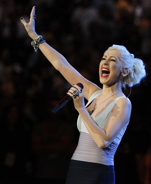 Christina Aguilera sings the national anthem before Game 7 of the NBA basketball finals between the Los Angeles Lakers and the Boston Celtics on Thursday, June 17, 2010, in Los Angeles. (AP Photo/Jae C. Hong)