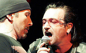 The Edge and Bono of U2 perform at TD BankNorth Garden in Boston, Sunday, Dec. 4, 2005. (AP Photo/Robert E. Klein)