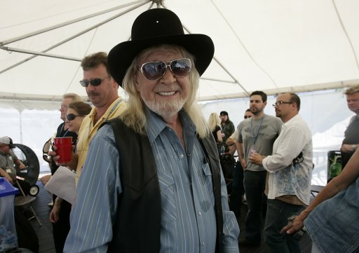 "In this 2008 photo, Mel McDaniel waits backstage at the CMA Music Festival in Nashville, Tenn. McDaniel, whose goodtime songs included ""Baby's Got Her Blue Jeans On"" and ""Louisiana Saturday Night"" has died. He was 68. Darleen Bieber of Schmidt Relations, the publicists for the Grand Ole Opry, confirmed Friday, April 1, 2011, that McDaniel had died, but had no details. (AP Photo/The Tennessean, John Partipilo)"