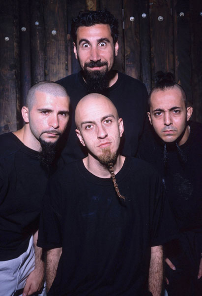 UNSPECIFIED - JANUARY 01:  Photo of Serj TANKIAN and SYSTEM OF A DOWN and John DOLMAYAN and Shavo ODADJIAN and Daron MALAKIAN; L-R (front): John Dolmayan, Shavo Odadjian, Daron Malakian; (back): Serj Tankian - posed, studio, group shot  (Photo by Mick Hutson/Redferns)