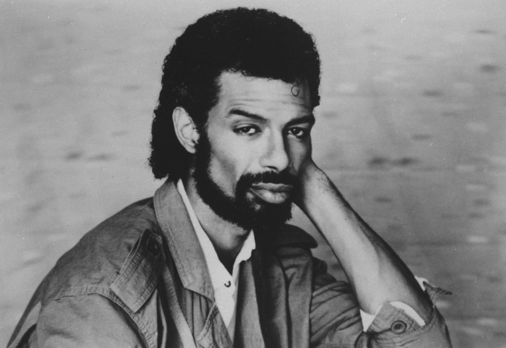 """FILE - In the Sept. 1984 file photo, musician Gil Scott-Heron poses. Scott-Heron, who helped lay the groundwork for rap by fusing minimalistic percussion, political expression and spoken-word poetry on songs such as """"The Revolution Will Not Be Televised"""" but saw his brilliance undermined by a years-long drug addiction, died Friday, May, 27, 2011 at age 62. (AP Photo, File)"""
