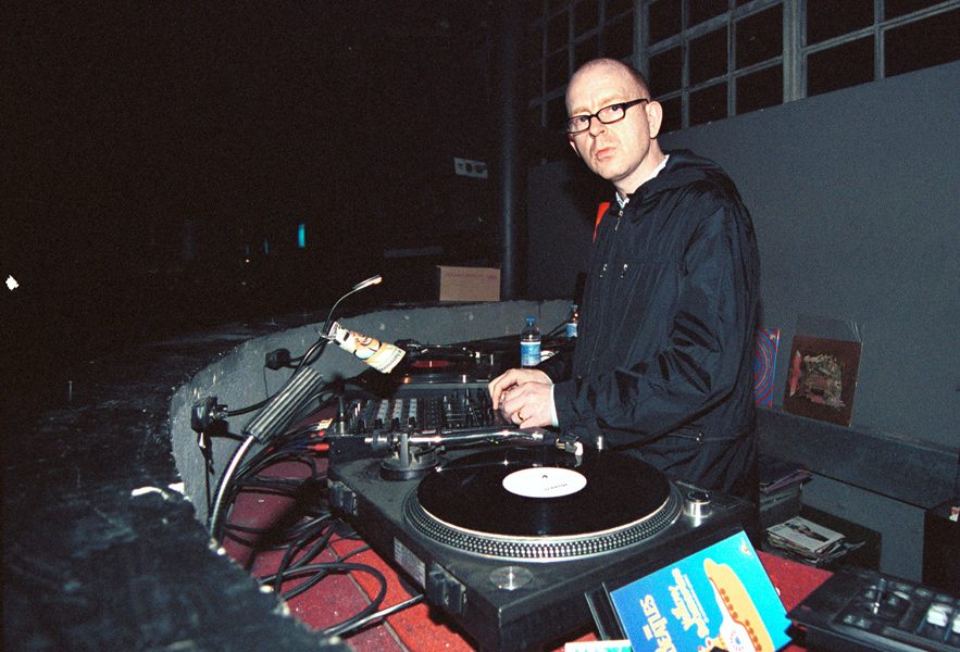 Alan McGee photographed performing a  live DJ set in Italy