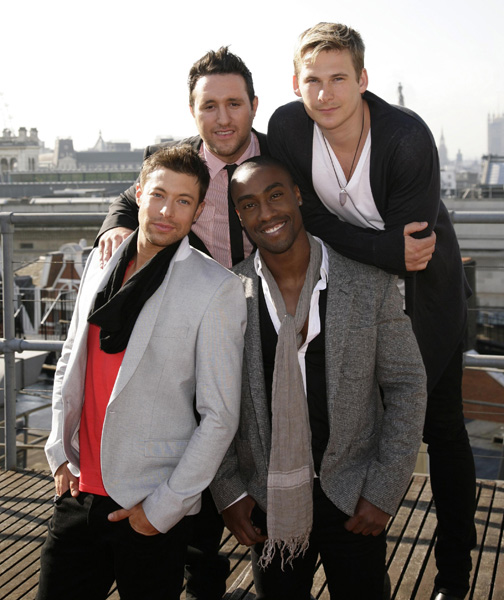 Pop band Blue, from left: Duncan James, Anthony Costa, Simon Webbe, and Lee Ryan announce their reformation during a visit to Capital Radio, at Leicester Square in central London.