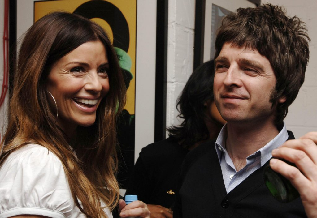 Noel Gallagher and girlfriend Sarah McDonald, who is five months pregnant, at a private view of Lawrence Watson's (NME photographer) music photography at Studio 2 in east London.