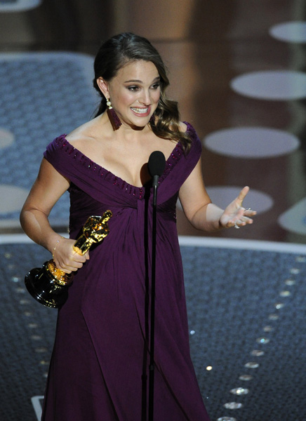 "Natalie Portman accepts the Oscar for best performance by an actress in a leading role for ""Black Swan"" at the 83rd Academy Awards on Sunday, Feb. 27, 2011, in the Hollywood section of Los Angeles. (AP Photo/Mark J. Terrill)"
