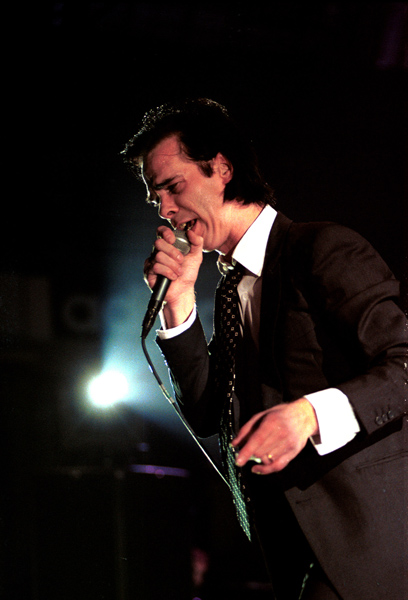 Nick Cave photographed performing live on stage in Italy