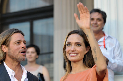 Angelina Jolie and Bred Pitt arrive on the red carpet during the final night of the 17th Sarajevo film festival in Sarajevo in Sarajevo, Bosnia, on Saturday, July 30,2011. Angelina Jolie and Brad Pitt have arrived in Bosnia's capital to take part in the closing ceremony of the eight-day Sarajevo Film Festival. Festival organizers said Saturday the actress will be receiving a special award during the surprise visit. Jolie visited Bosnia last year several times as UNHCR ambassador and drew attention to the plight of 117,000 people who haven't able to return to their homes even though the Bosnia war ended 15 years ago.(AP Photo/STR)