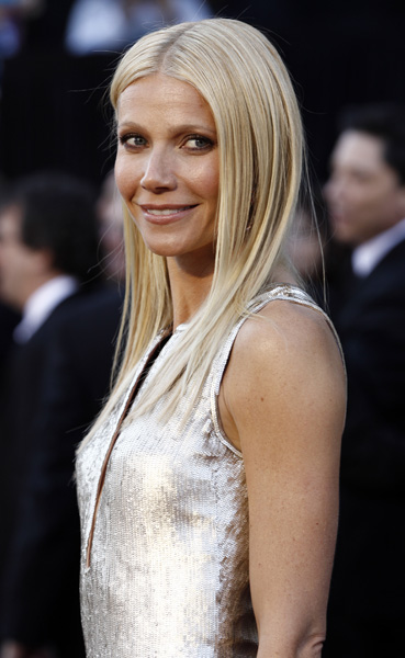 Gwyneth Paltrow arrives before the 83rd Academy Awards on Sunday, Feb. 27, 2011, in the Hollywood section of Los Angeles. (AP Photo/Matt Sayles)