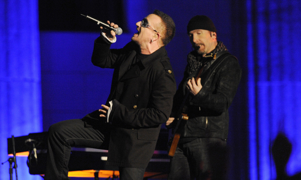 Guitarist The Edge and singer Bono (L) of the Irish rock band U2 perform on stage during their concert at Brandenburg Gate in Berlin, Germany