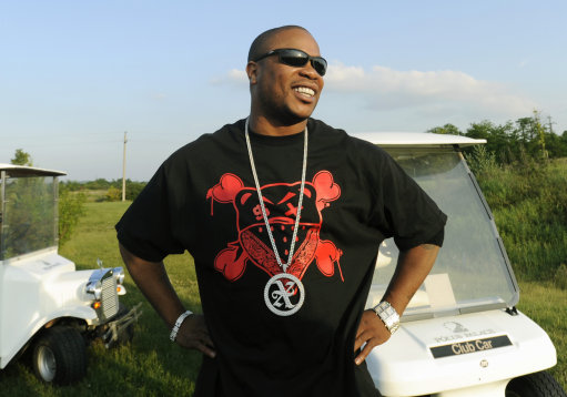 US rapper Xzibit is seen while playing golf in Goed (40 km (25 miles) east of Budapest, Hungary, Friday, June 5, 2009. Xzibit arrived to Hungary Friday to perform on a concert and to participate on an American car and tuning show on Saturday. (AP Photo/Bela Szandelszky)