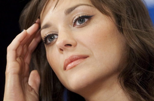 """Marion Cotillard during a press conference for the film Little White Lies during the 2010 Toronto International Film Festival in Toronto Sunday, September 12, 2010. Cotillard has high praise for Canadian Rachel McAdams, her co-star in Woody Allen's upcoming comedy """"Midnight in Paris,"""" due out next year. THE CANADIAN PRESS/Darren Calabrese"""