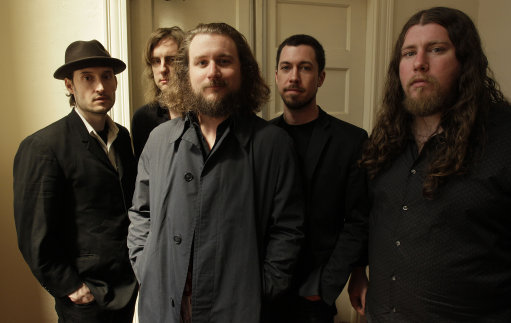 In this Wednesday, April 13, 2011 photo, members of My Morning Jacket, from left, Bo Koster, Carl Broemel, Yim Yames, Tom Blankenship and Patrick Hallahan pose for a photograph in Louisville, Ky. (AP Photo/Ed Reinke)