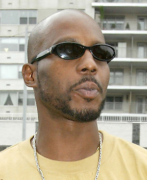 ** FILE ** Rapper DMX, whose real name is Earl Simmons, arrives for a court appearance at Criminal Court in the Queens Borough of New York, Friday, July 23, 2004. Simmons was charged Monday Aug. 8, 2005 with violating the conditions of a deal he struck with prosecutors last year after driving through an airport parking gate while on drugs. (AP Photo/Diane Bondareff)