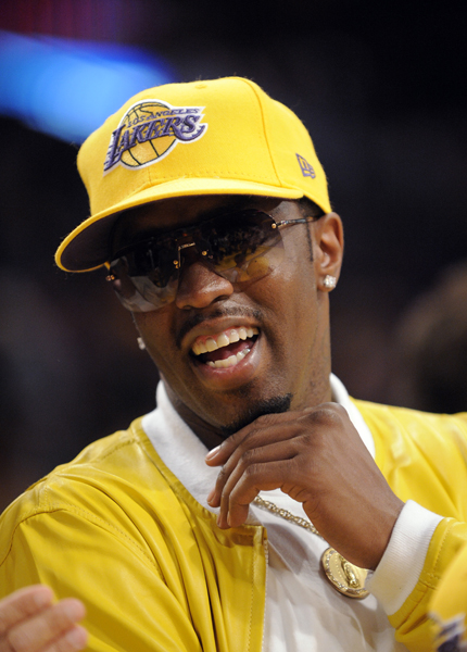 Sean 'Diddy' Combs sits courtside during the first half of Game 2 of the NBA basketball finals between the Los Angeles Lakers and Orlando Magic Sunday, June 7, 2009, in Los Angeles. (AP Photo/Mark J. Terrill)