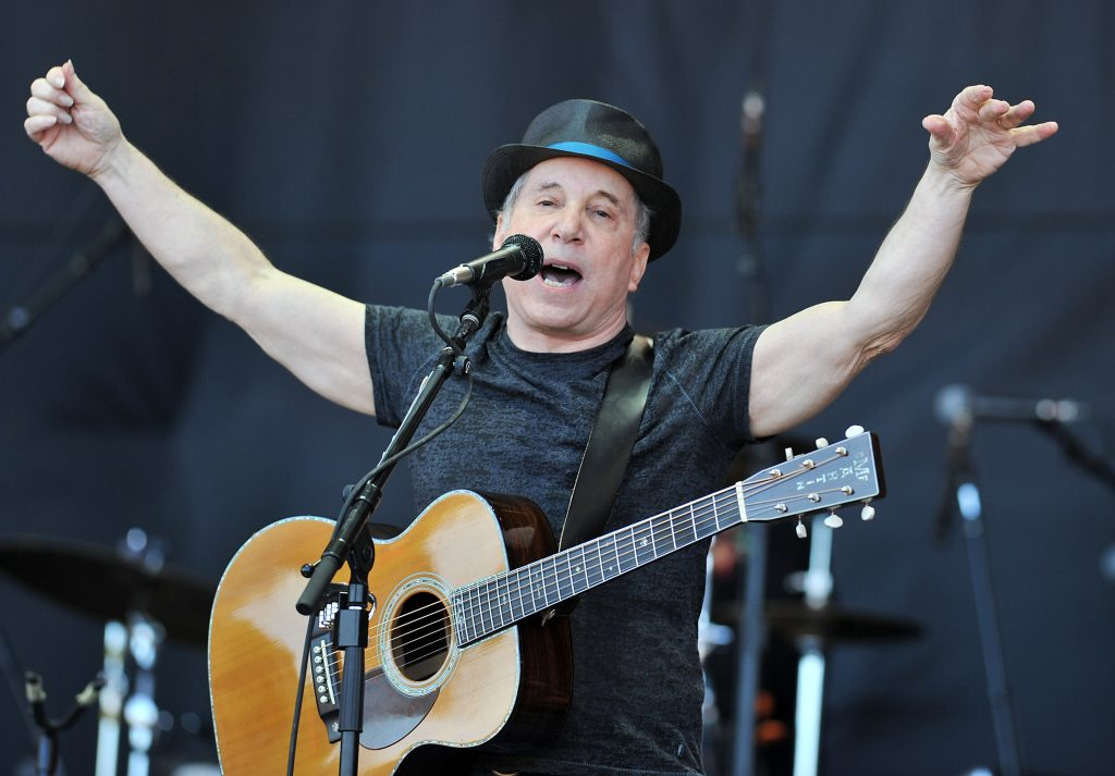 US singer Paul Simon performs on the Pyramid stage at Glastonbury Festival in Glastonbury, England on Sunday June 26, 2011. (AP Photo/Mark Allan)