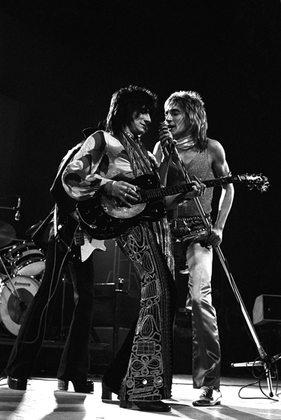Rod Stewart and Ronnie Wood (left) of The Faces on stage at a concert in Kilburn