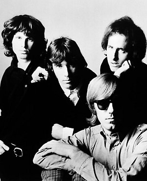 *** FILE *** Members of The Doors, from left to right, Jim Morrison, John Densmore, Robby Krieger and Ray Manzarek are shown in this undated file photo. The end is near for a bitter legal dispute between the three surviving members of The Doors now that the California Supreme Court has refused to take up their case on Aug. 13, 2008. Keyboardist Ray Manzarek and guitarist Robby Krieger are on the hook for more than $5 million after they were found by lower courts to have improperly invoked The Doors' name and images during a 2003 concert tour. After the high court declined to hear their appeal they'll have to pay up to drummer John Densmore, the parents of the deceased lead singer Jim Morrison and the parents of Morrison's deceased wife, Pamela Courson, who died in 1974. (AP Photo, FILE)
