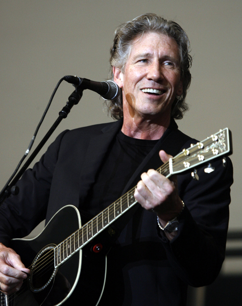 Former Pink Floyd leader bassist Roger Waters performs on an open air stage for the 100th anniversary of the French Formula One Grand Prix at the Magny-Cours circuit, central France, Friday July 14, 2006. (AP Photo/Christian Lutz)