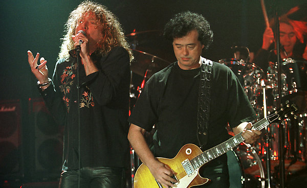 ** FILE ** Led Zeppelin's Robert Plant, left, performs with guitarist Jimmy Page during their concert in Istanbul in this March 5, 1998, file photo. (AP Photo/Murad Sezer, file)