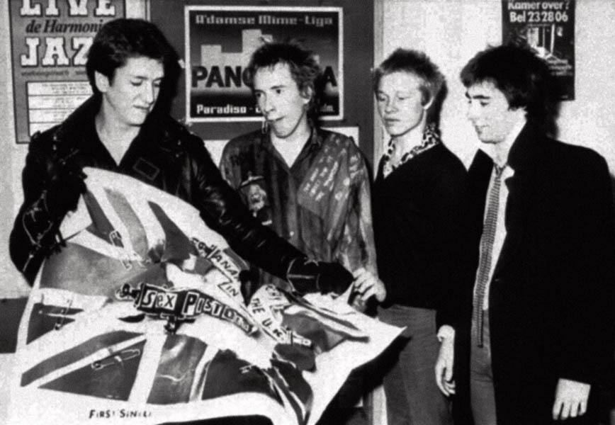 06/11/1975 : On this day in 1975 the Sex Pistols played their first gig at St Martins School of Art in London. Punk rock group The Sex Pistols rearing an EMI poster after the announcement that they have split with their record company. EMI said it felt unable to promote the group in view of adverse publicity.  22/02/04: The group's Anarchy In The UK has been named the most influential record of the 1970s in a poll by Q magazine. It beat Queen's Bohemian Rhapsody and the Donna Summer disco classic I Feel Love in the list of the decade's landmark records.