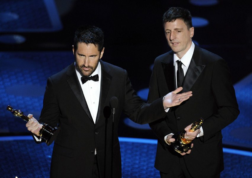 "Trent Reznor and Atticus Ross accept the award for best original score for ""The Social Network"" during the 83rd Academy Awards on Sunday, Feb. 27, 2011, in the Hollywood section of Los Angeles. (AP Photo/Mark J. Terrill)"