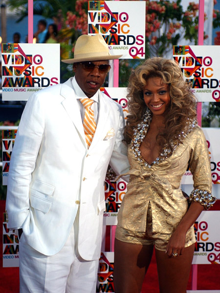 Rap artist Jay-Z, left, and Beyonce arrive for the MTV Video Music Awards in Miami, Sunday, Aug. 29, 2004. (AP Photo/Alan Diaz)