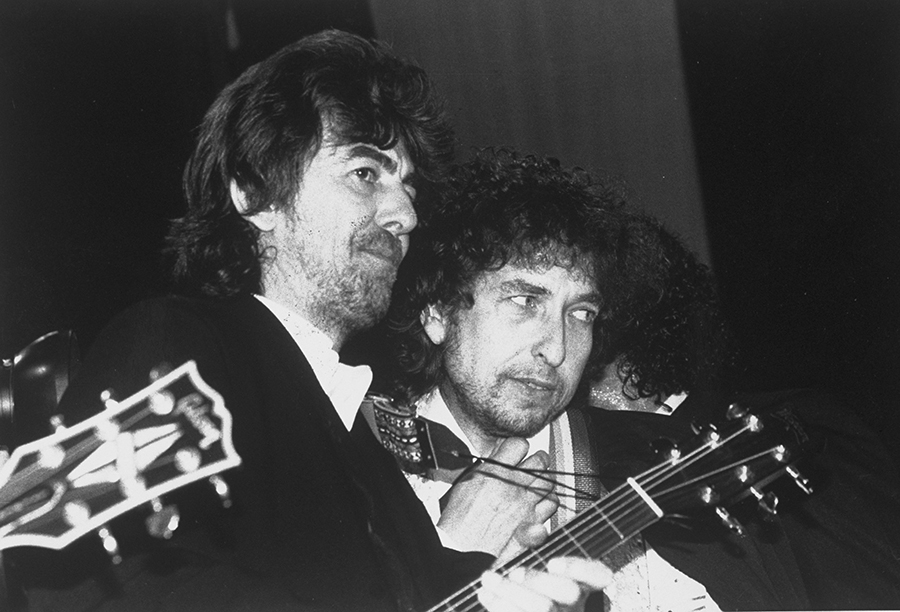 UNITED STATES - JANUARY 22:  George Harrison (left) and Bob Dylan at the Rock 'n' Roll Hall of Fame induction ceremonies at the Waldorf-Astoria.  (Photo by Richard Corkery/NY Daily News Archive via Getty Images)