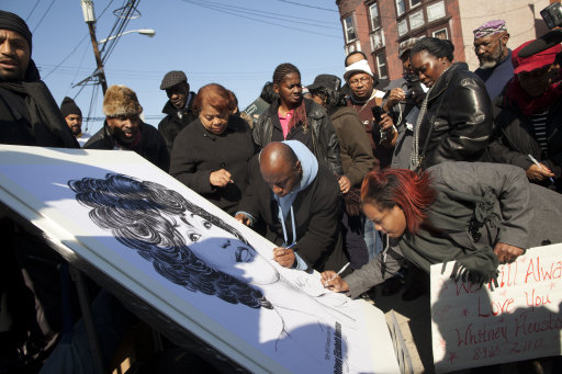 Whitney Houston fans gather close to the New Hope Baptist church where the singers funeral service is being held today in Newark, NY, USA on February 18, 2012.