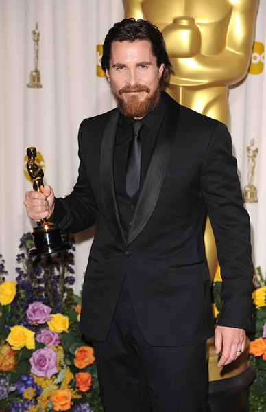 Christian Bale with the Best Supporting Actor award, received for The Fighter, at the 83rd Academy Awards at the Kodak Theatre, Los Angeles.
