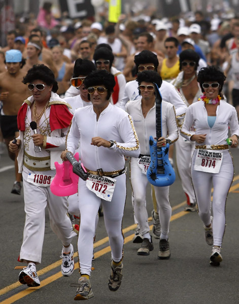 A group of runners dressed as Elvis Presley lead at the start of the Rock 'n' Roll Marathon in San Diego, Sunday, June 4, 2006. Over 20,000 runners took part in the annual music themed race. (AP Photo/Denis Poroy)
