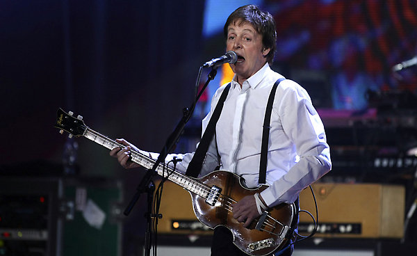 British musician Sir Paul McCartney, winner of the Oustanding Contribution to Music Award, performs at the Brit Awards 2008 in London, Wednesday, Feb. 20, 2008. (AP Photo/Matt Dunham)