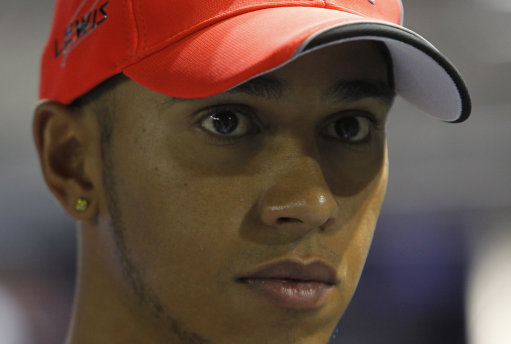 McLaren driver Lewis Hamilton of Britain pauses in the pit lane on the Marina Bay City Circuit for Sunday's Singapore Formula One Grand Prix in Singapore, Thursday, Sept. 22, 2011. (AP Photo/Terence Tan)